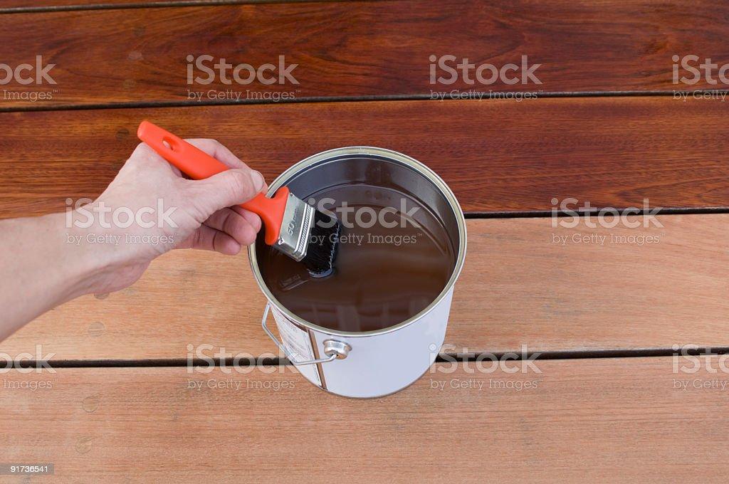 Staining Hardwood Timber Patio  Decking royalty-free stock photo