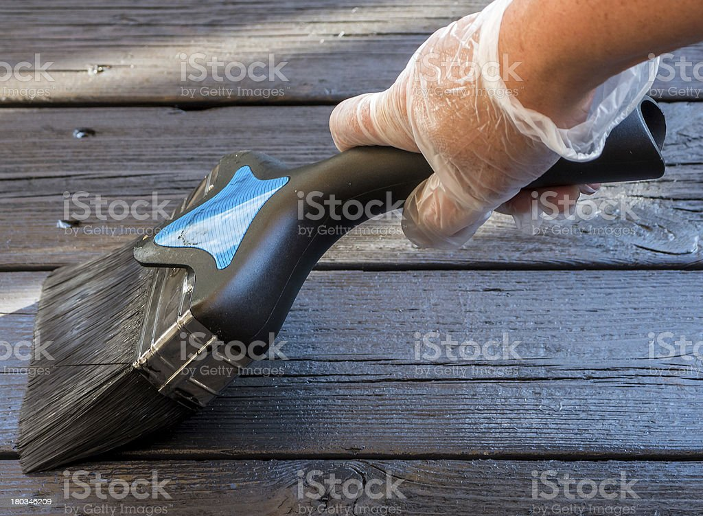 Staining the patio decking stock photo