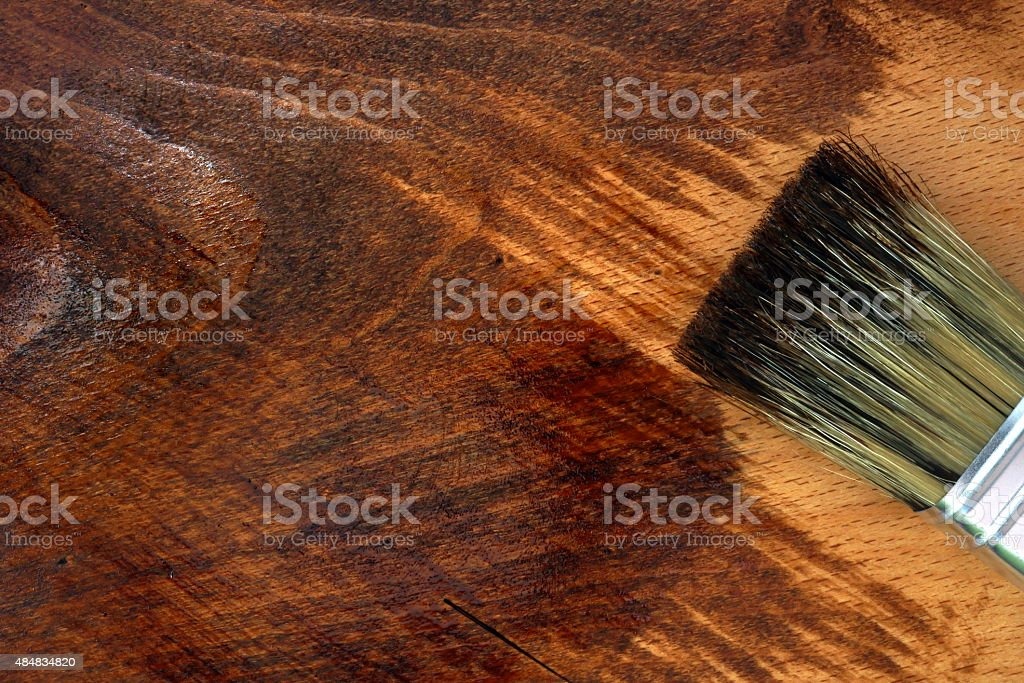 Staining wooden surface. Home decorating concept. stock photo