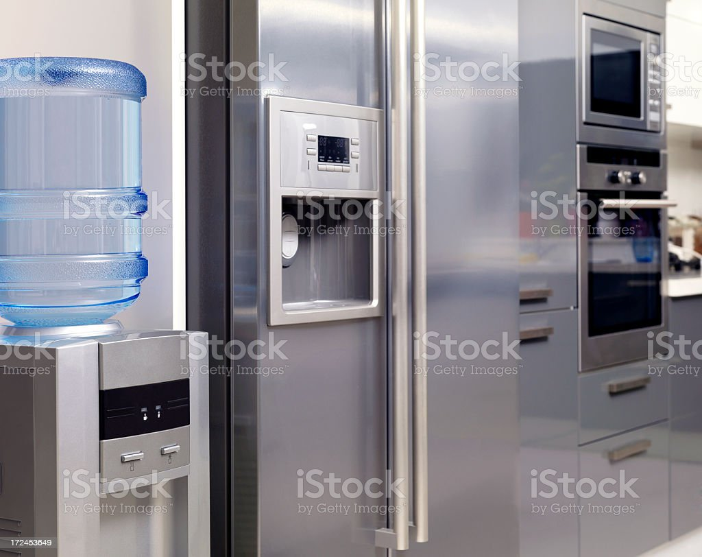 Stainless appliances and water dispenser of a modern kitchen stock photo