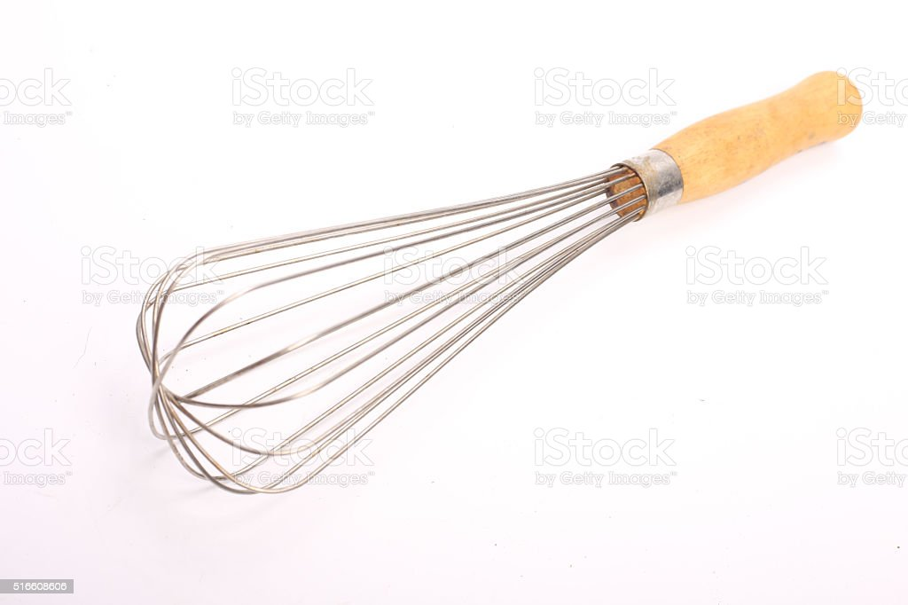 Stainless balloon whisk isolated stock photo