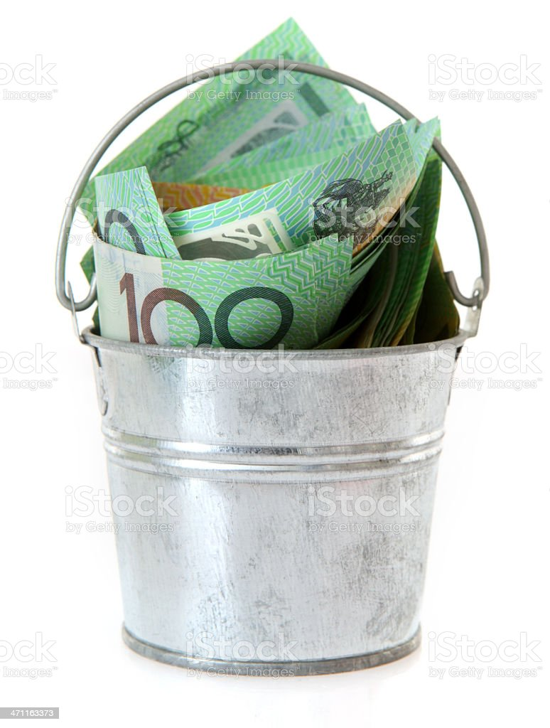 Stainless bucket filled with a hundred dollar notes stock photo