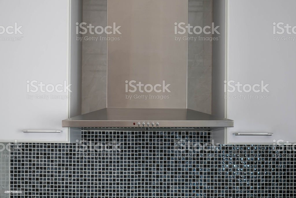 Stainless cooking hood with cabinet stock photo