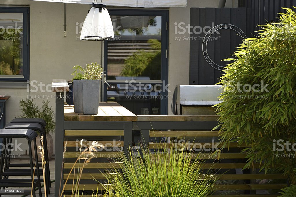 Stainless gas grill in an outdoor kitchen stock photo