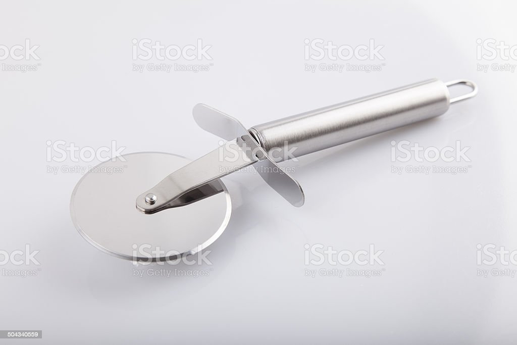 Stainless Metalic Pizza Cutter - Stock Image stock photo