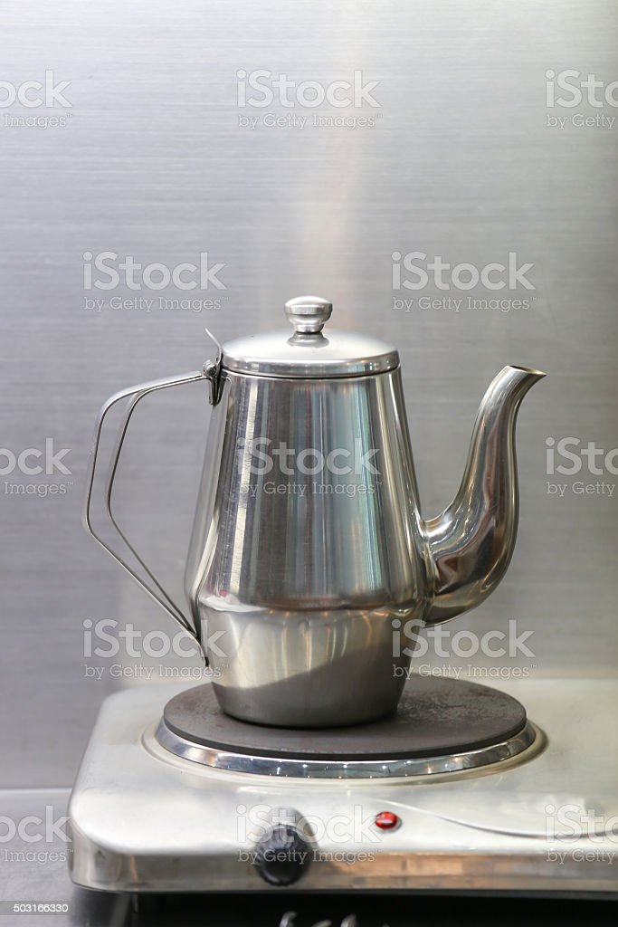 stainless pot on electric stove stock photo