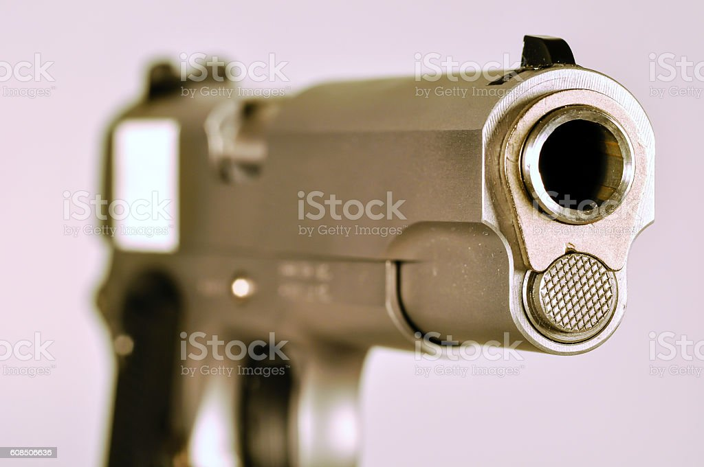 Stainless steel .45 Caliber semi automatic pistol stock photo