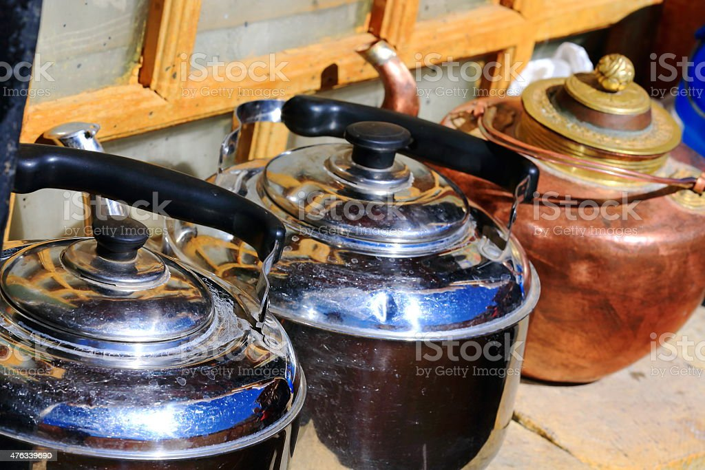 Stainless steel and copper stewpots. Drak Yerpa-Tibet. 1501 stock photo