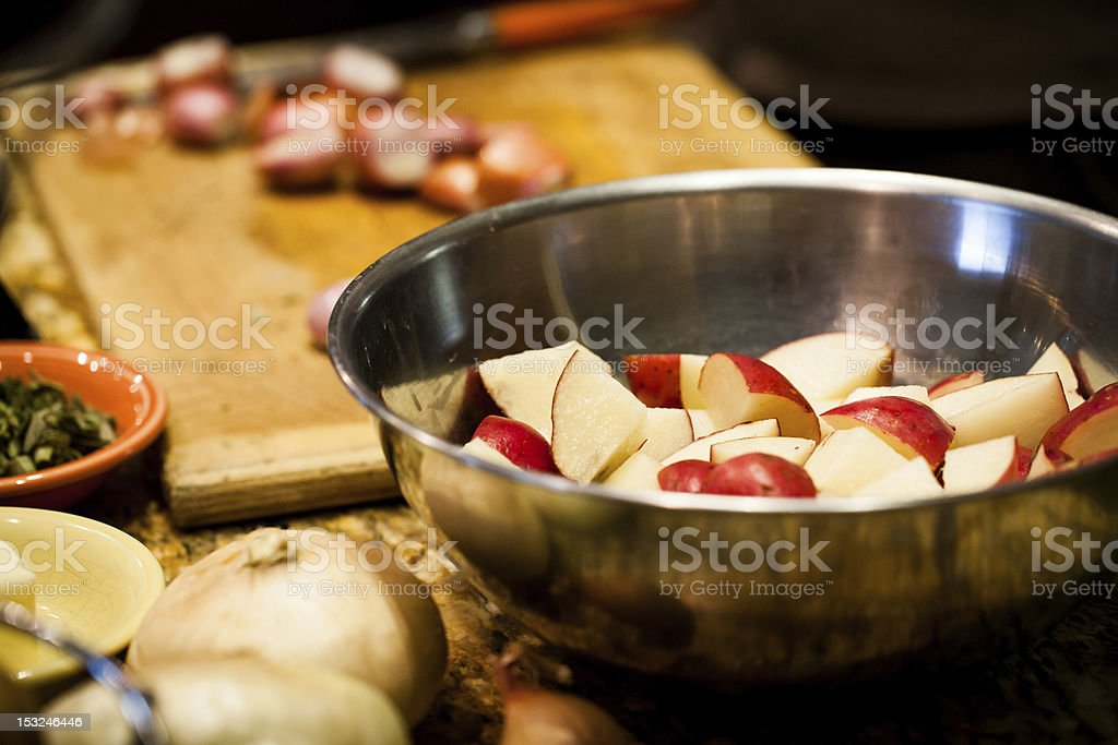Stainless Steel Bowl of Red Potatoes in the Kitchen royalty-free stock photo