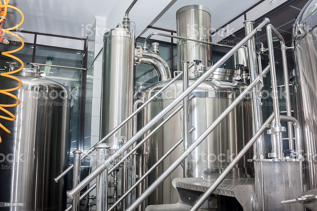 Stainless steel equipment of brewhouse stock photo