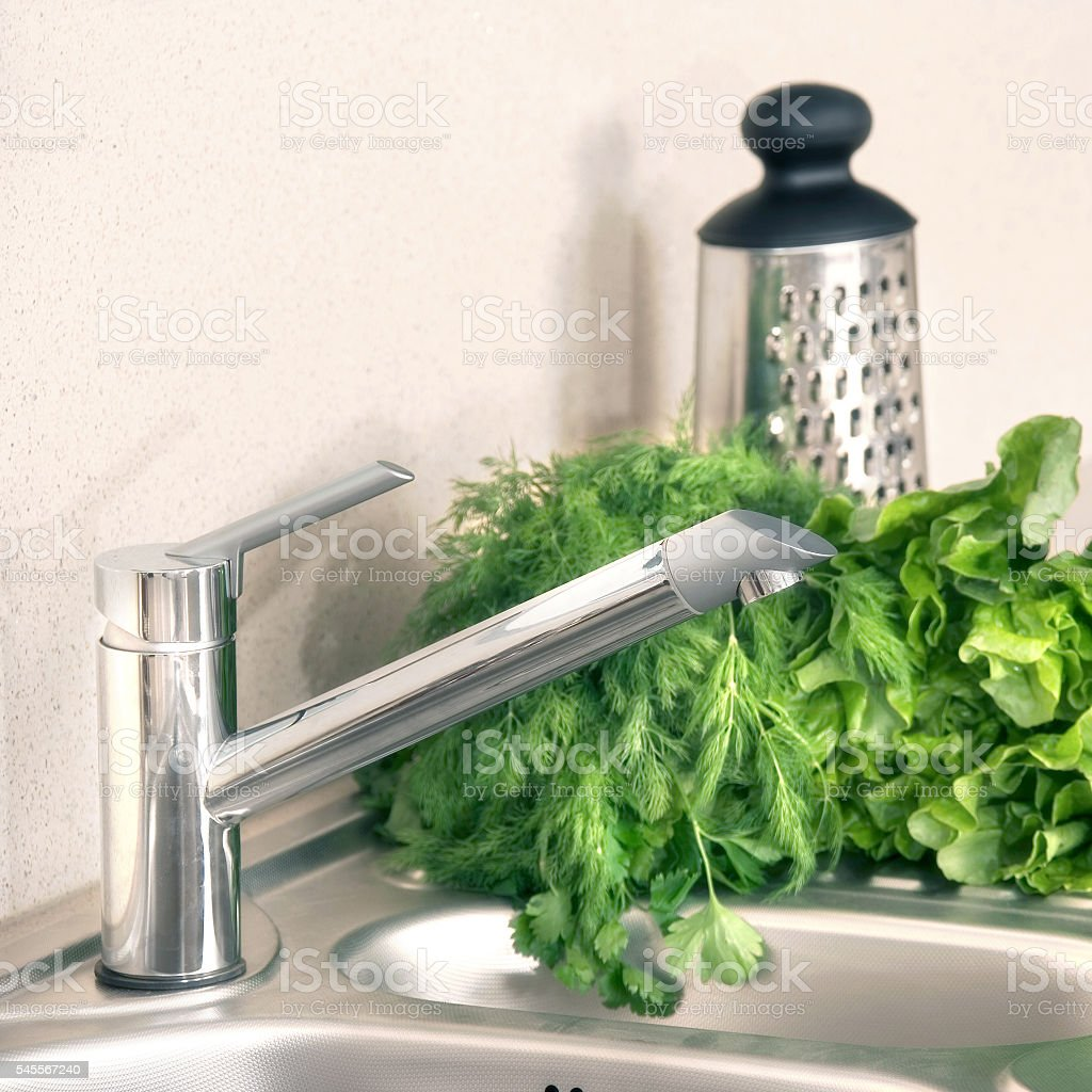 stainless steel faucet stock photo