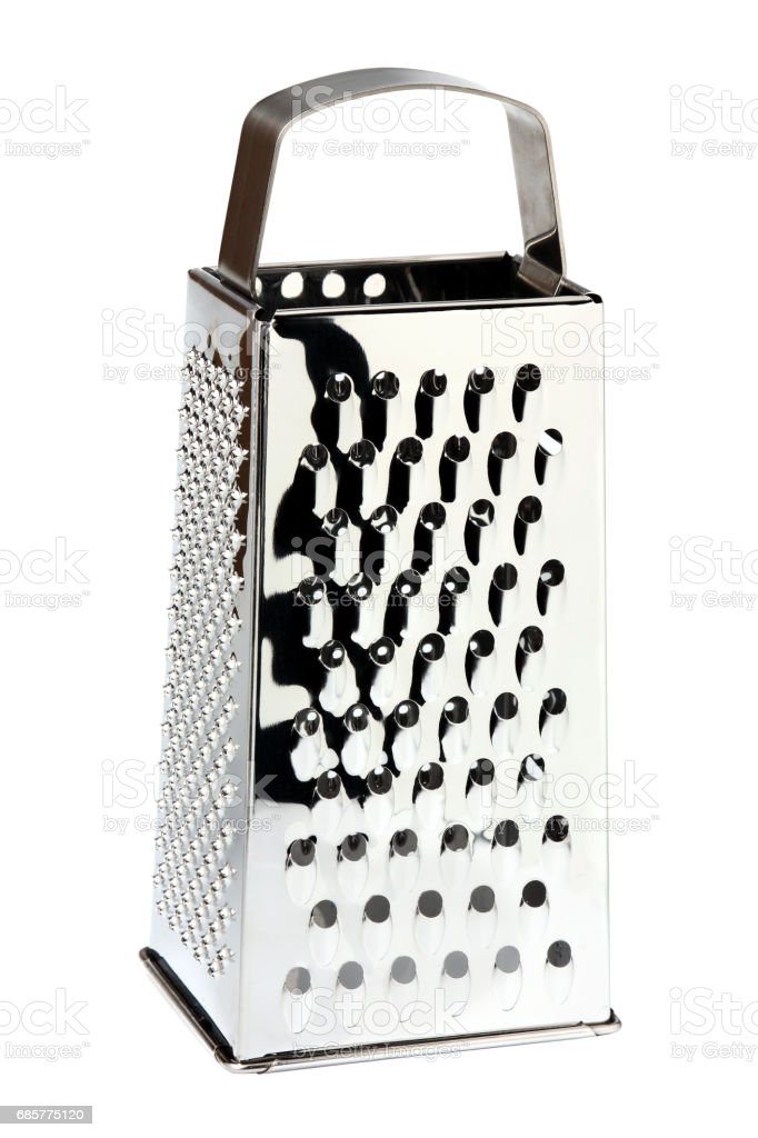 Stainless steel grater closeup isolated. stock photo