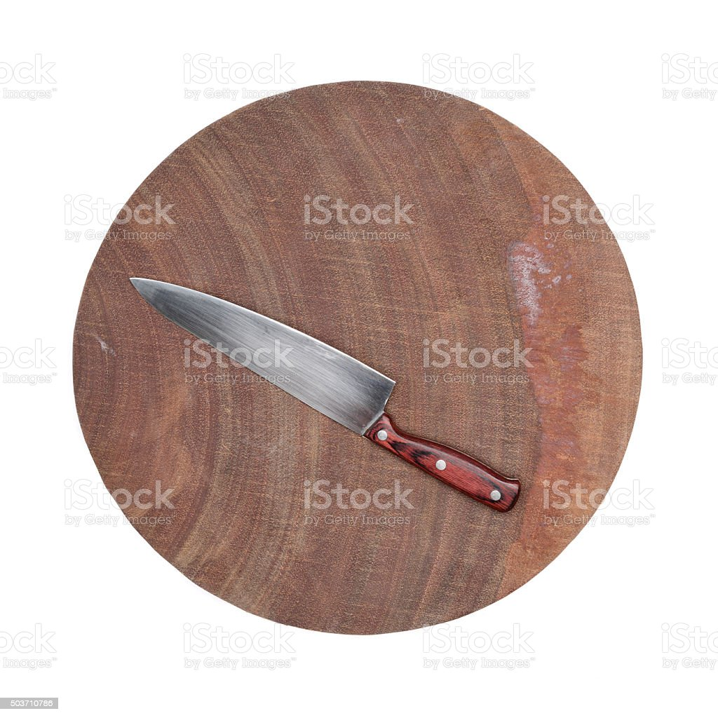 stainless steel kitchen utility knife on a wooden chopping board stock photo
