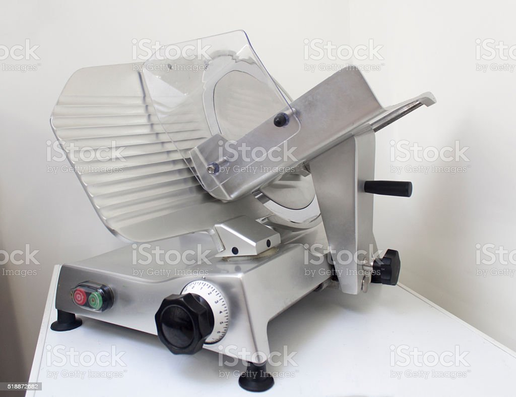 stainless steel meat slicer stock photo