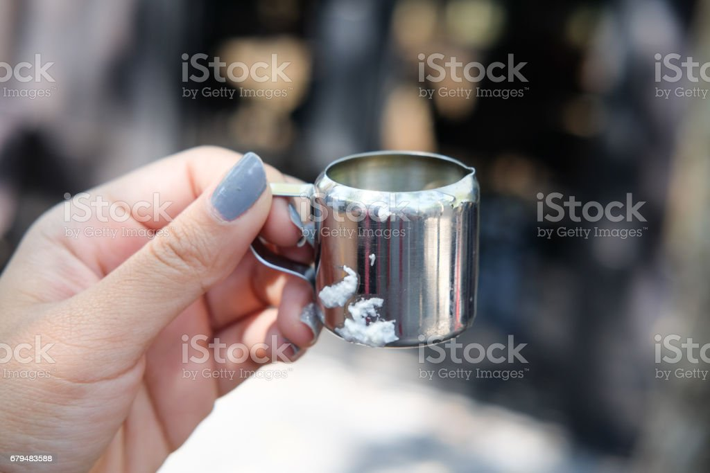 Stainless steel mini cup in hand stock photo