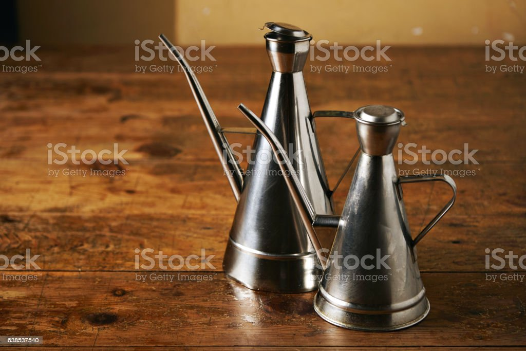 Stainless steel oil cruets stock photo