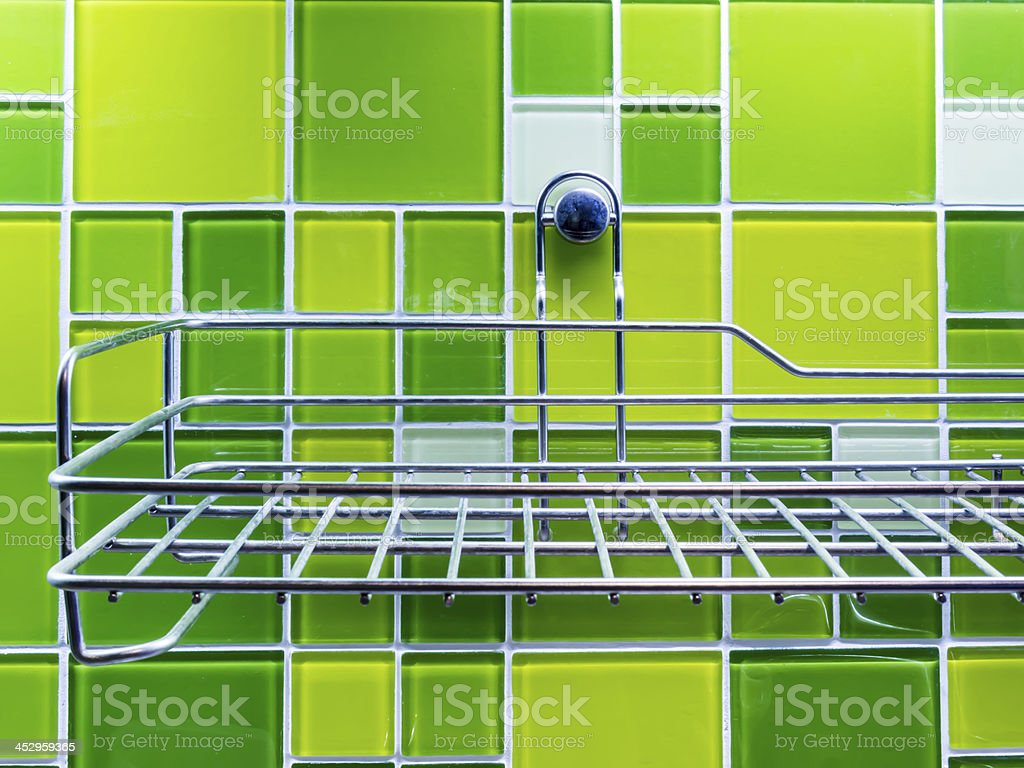 Stainless steel self on colorful wall tiles royalty-free stock photo