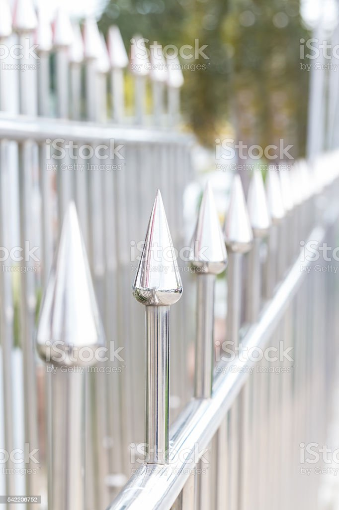 Stainless steel sharpened protection fence stock photo