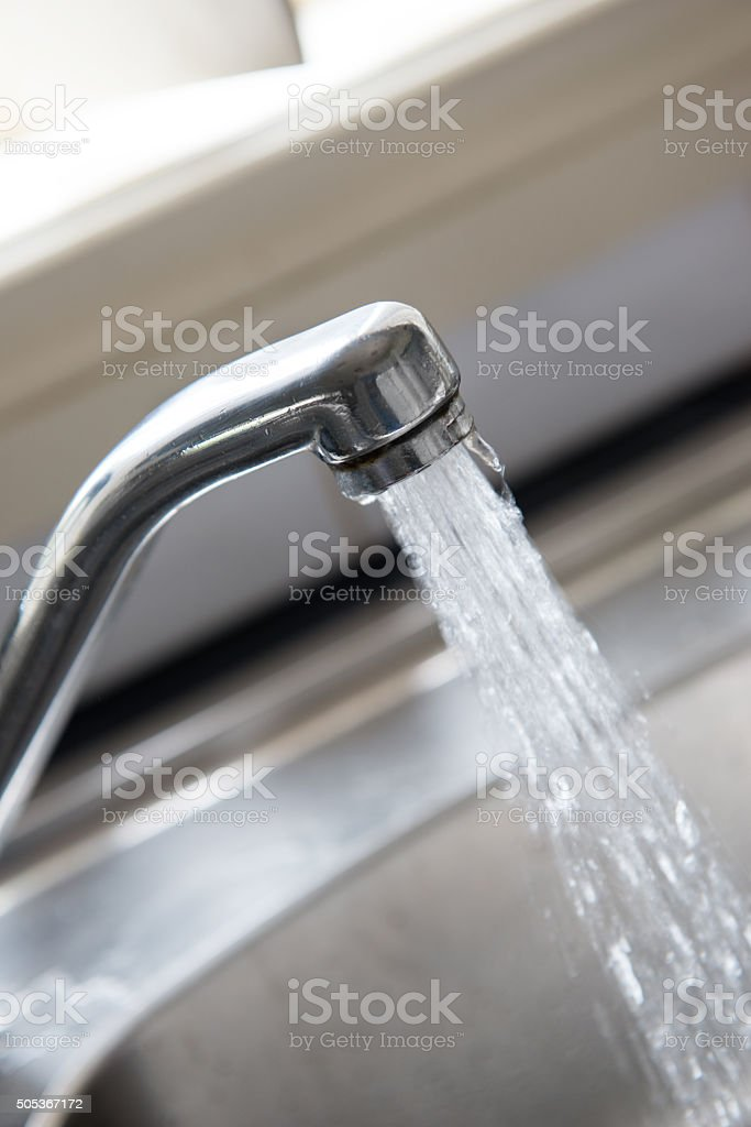 Stainless steel sink with mixer tap stock photo