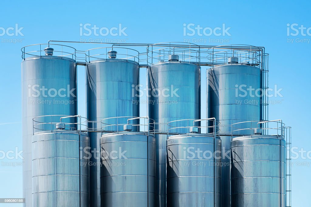 Stainless Steel storage tanks, clear blue sky. stock photo