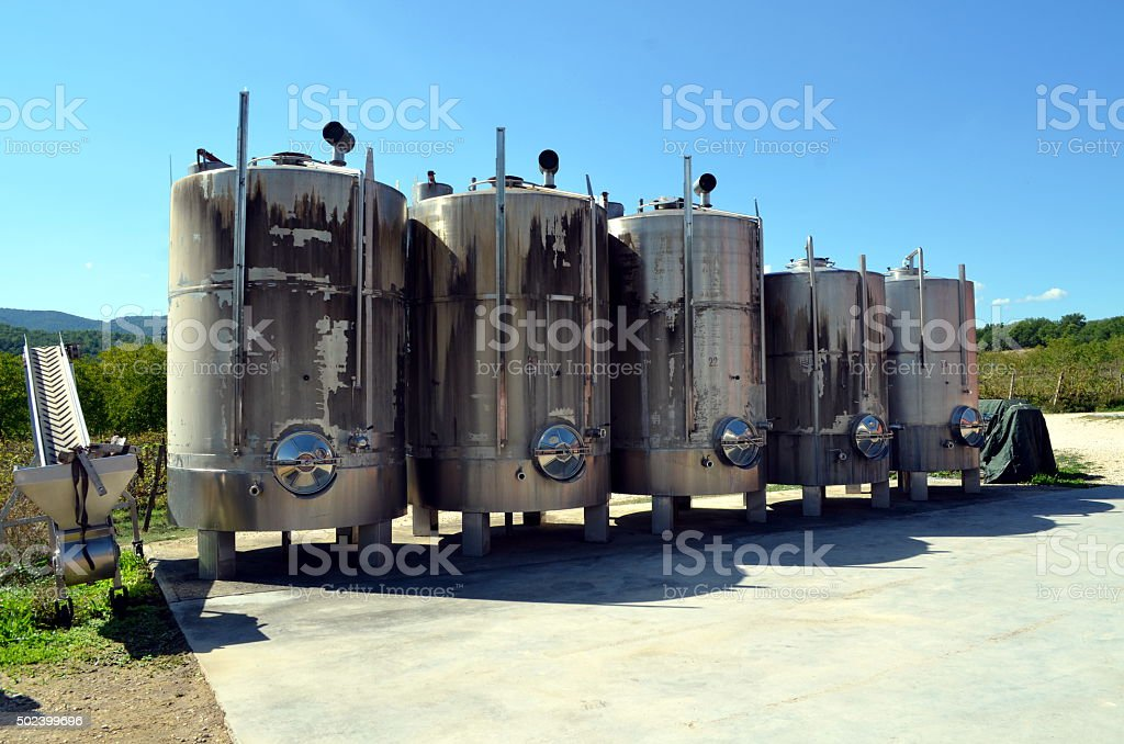 Stainless steel tanks for a fermentation of wine stock photo