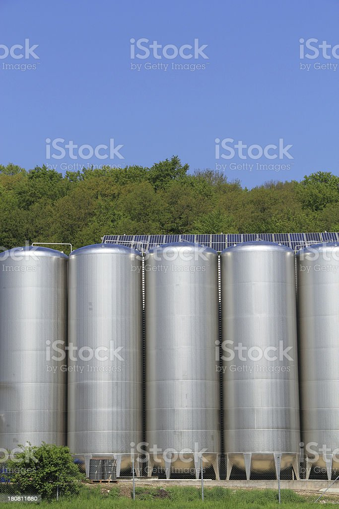 Stainless steel tanks with solar power stock photo