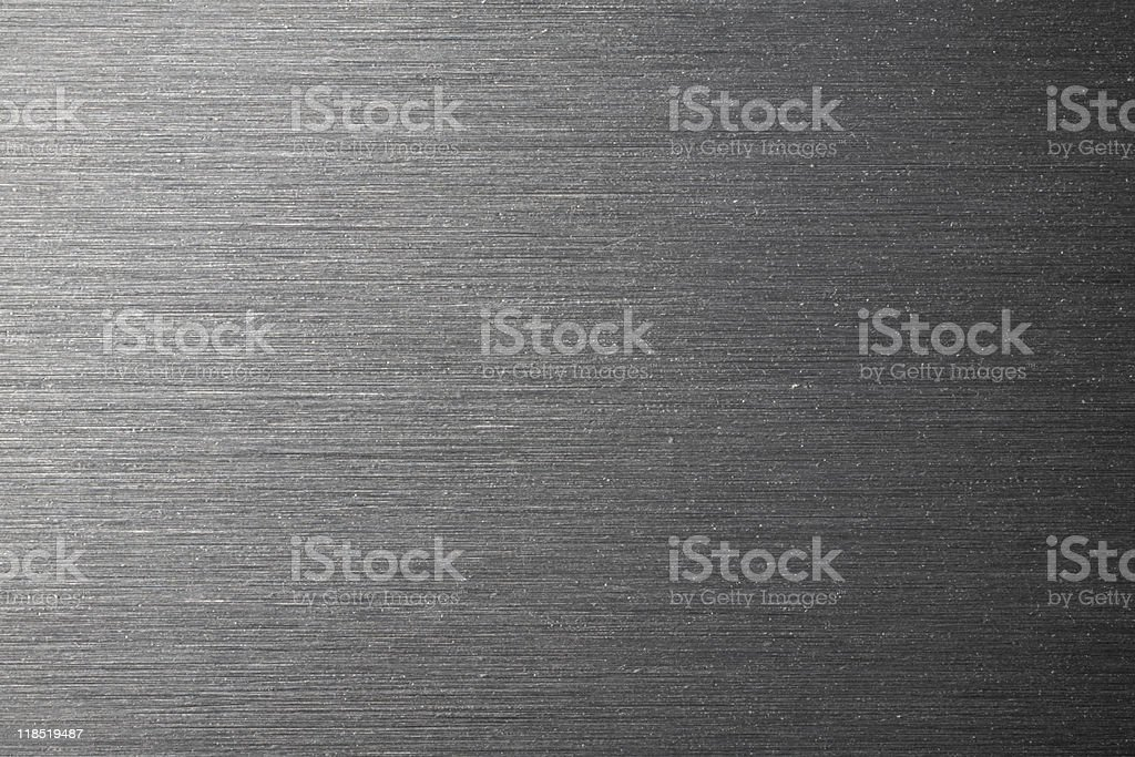 A stainless steel textured background with light stock photo