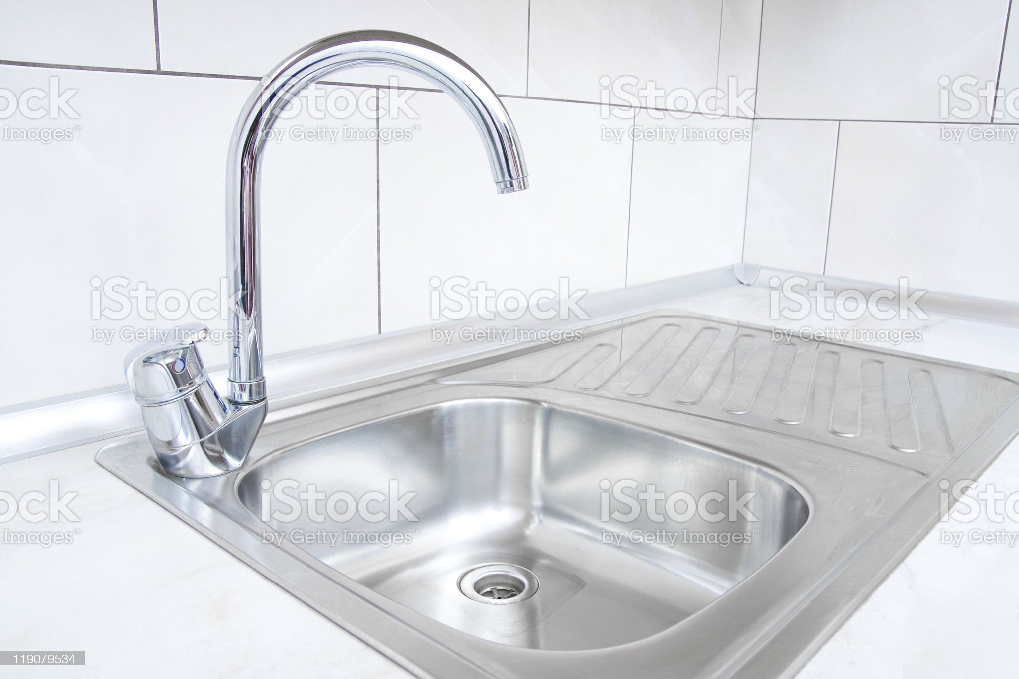 Stainless steel water basin with arched silver faucet royalty-free stock photo
