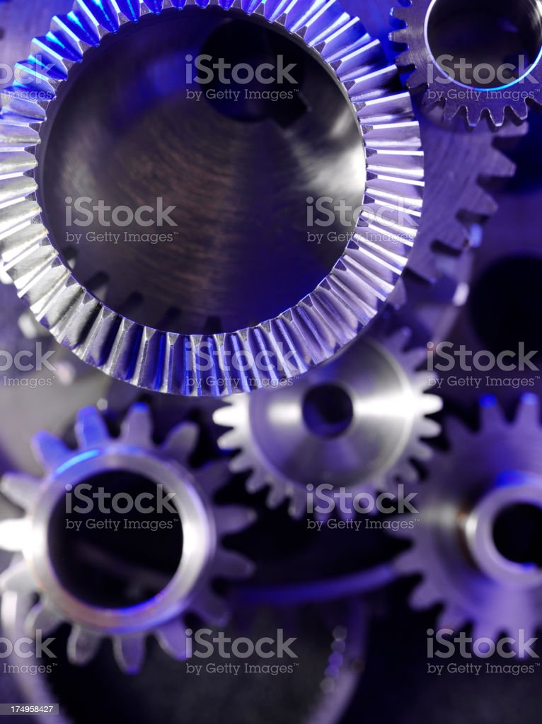 Stainless Steel Wheels and Cogs with Blue Lighting royalty-free stock photo