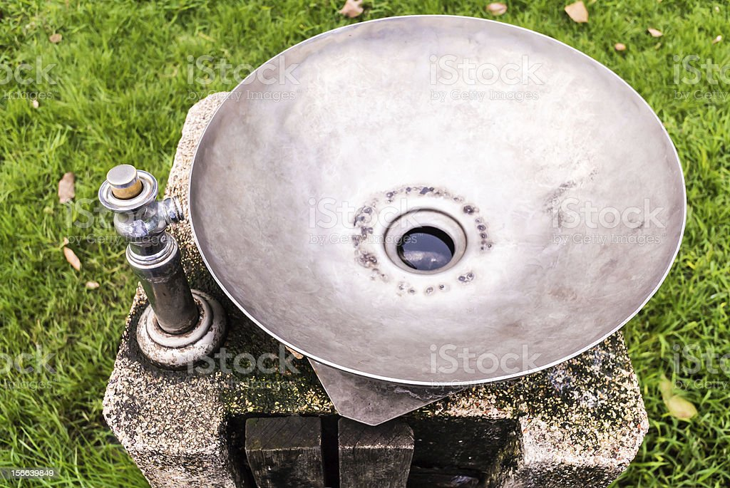 Stainless wash bowl in park royalty-free stock photo