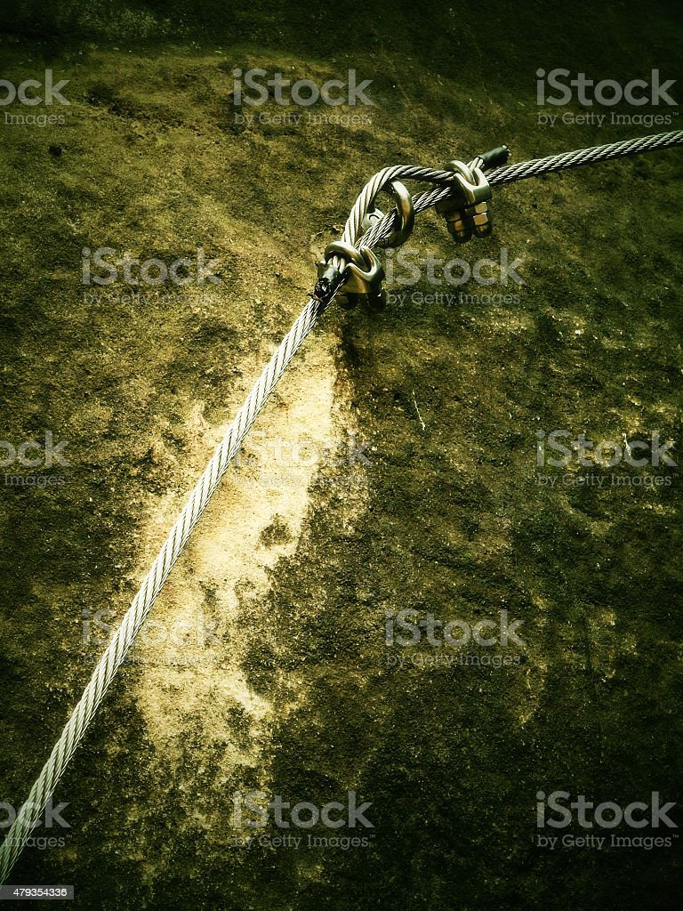 Stair climbing and irone rope on mountain via ferrata stock photo