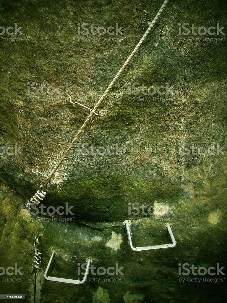 Stair climbing and irone twisted rope,via ferrata stock photo