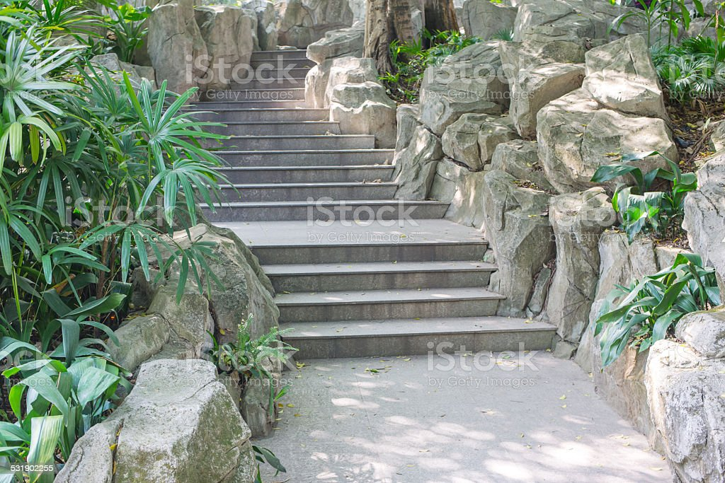 stair in a park with artificial rocks on each side stock photo