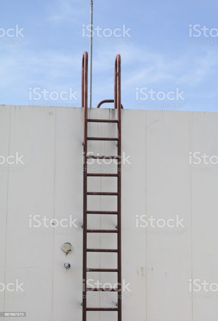 Stair old vertical industrial metal rusted. to Water tank no safety rails stock photo