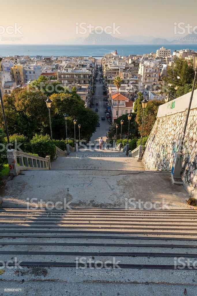 Staircase descending into a city stock photo