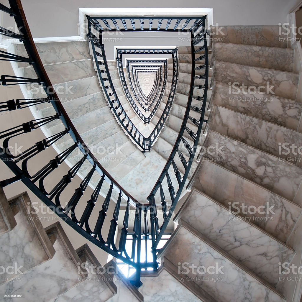 Staircase of a residential building from the early 1900s stock photo