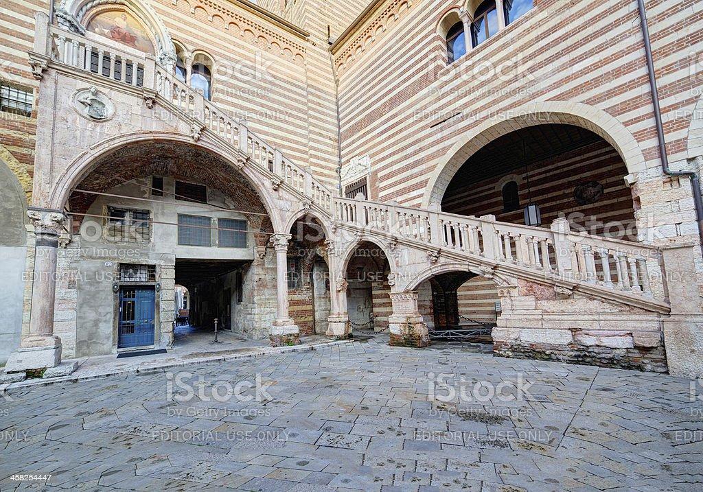 "Staircase of reason in ""Palazzo della Ragione"" at twilight. Verona-Italy royalty-free stock photo"