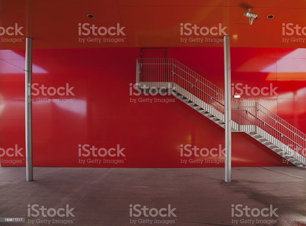 Staircase on red wall. royalty-free stock photo