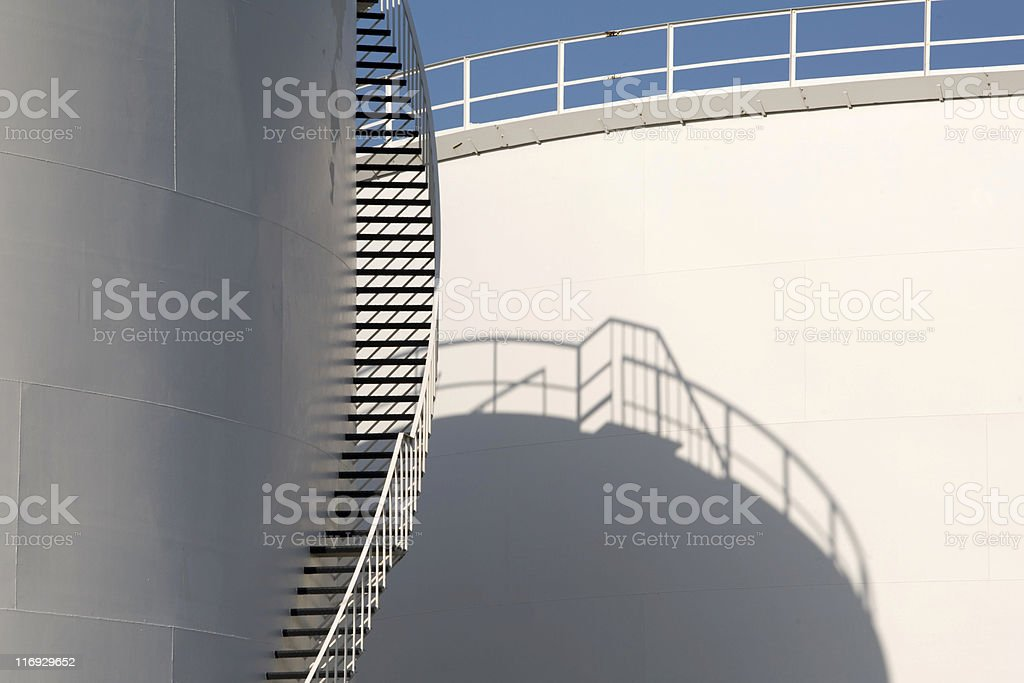 staircase on the outside of a fuel storage tank royalty-free stock photo
