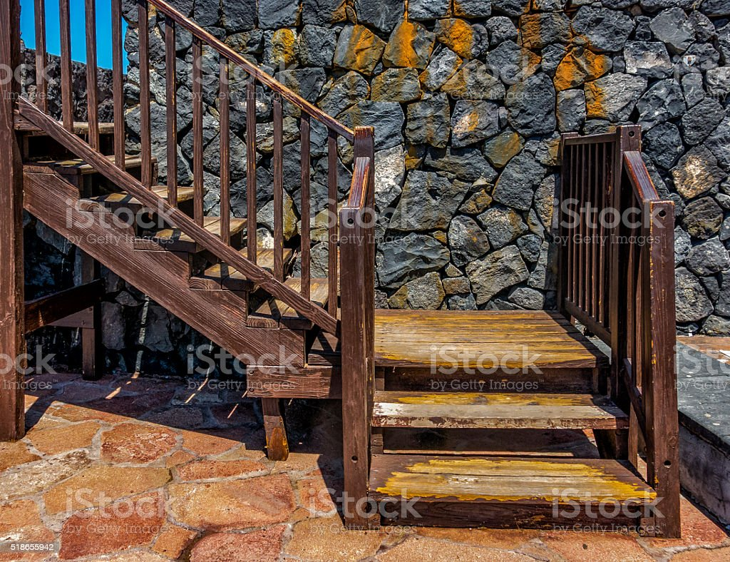 Staircase rails and bannister on rock ground stock photo