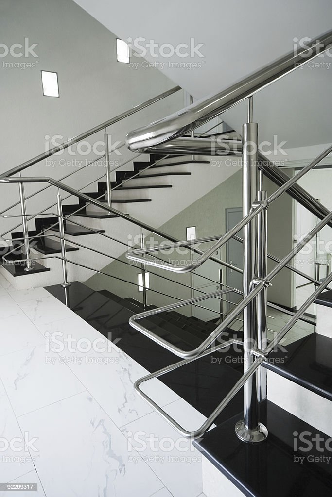 staircase with a steel handrail royalty-free stock photo