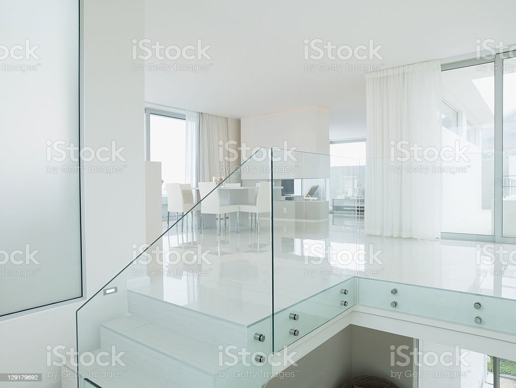 Staircase with glass railing in luxurious apartment royalty-free stock photo