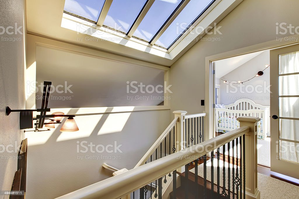 Staircase with skylight and baby room. stock photo