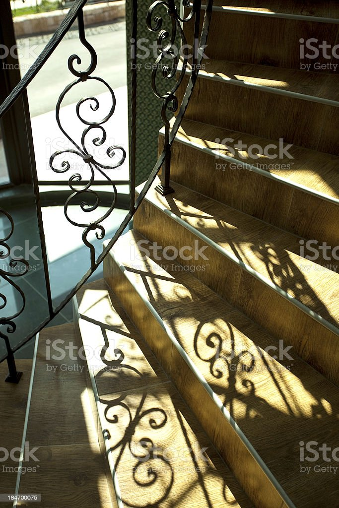 staircase with wrought iron railing royalty-free stock photo