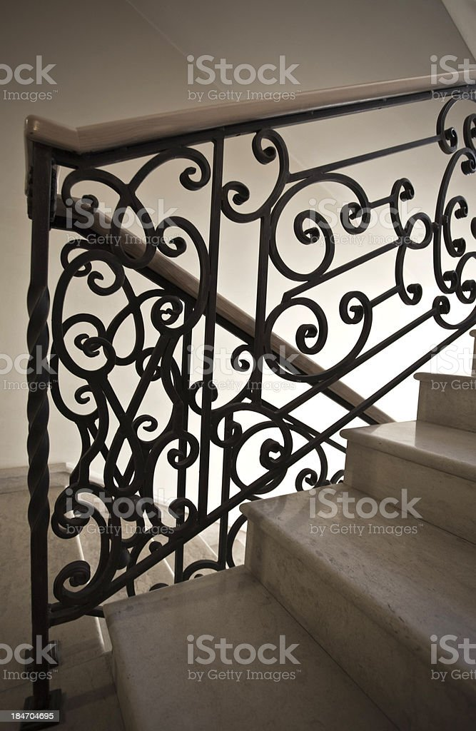 staircase with wrought iron railing stock photo