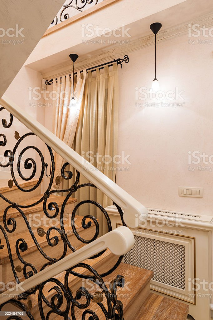 Staircase with wrought iron railings stock photo