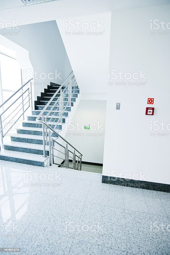 Staircases in very white office building with blue steps  stock photo
