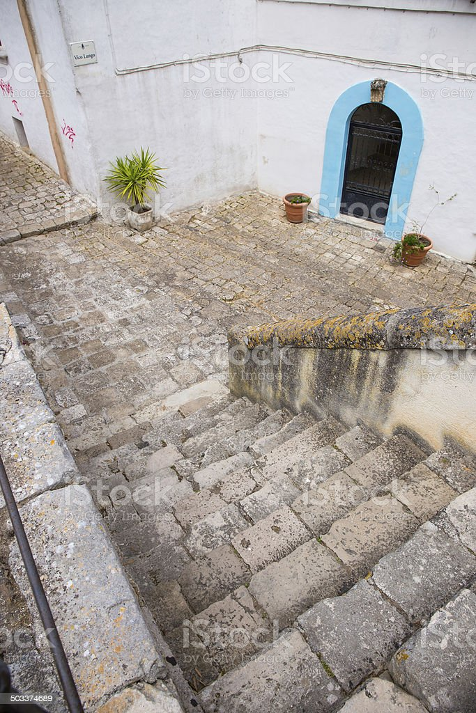 Stairs, alley and blue door in South Italy stock photo