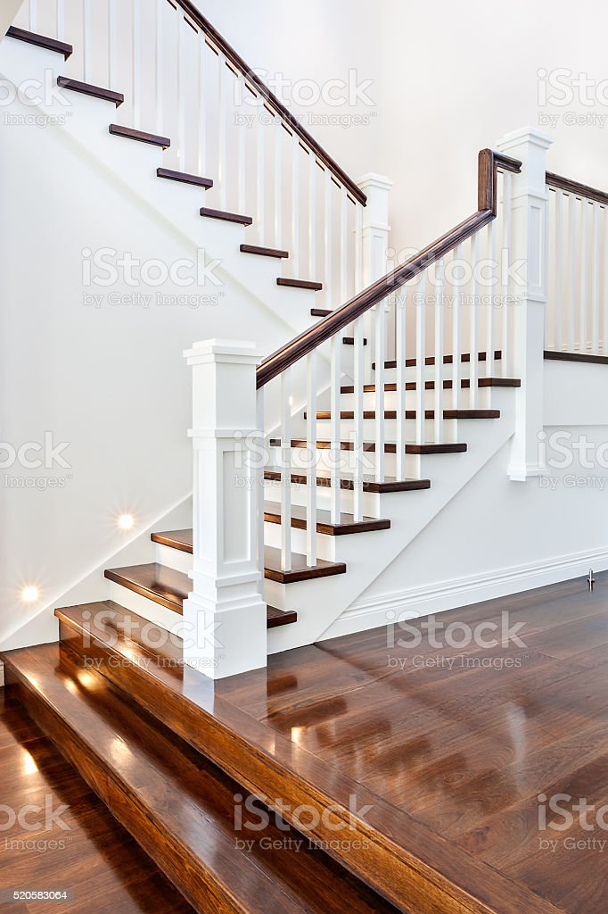 Stairs and glossy wooden floor of new house stock photo