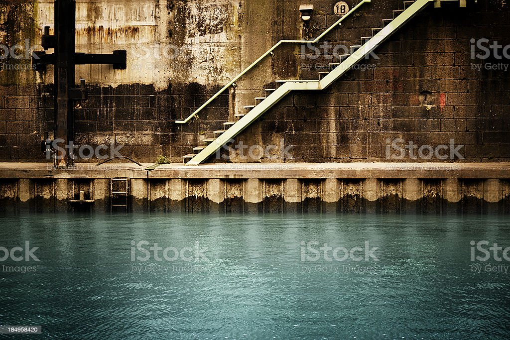 Stairs and wall at the harbor stock photo